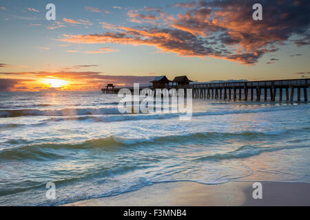Sunset over the Naples Pier on the west coast of Florida, USA - Stock Photo