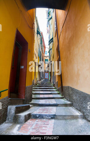 A narrow, charming alley in Vernazza, Cinque Terre, Italy - Stock Photo