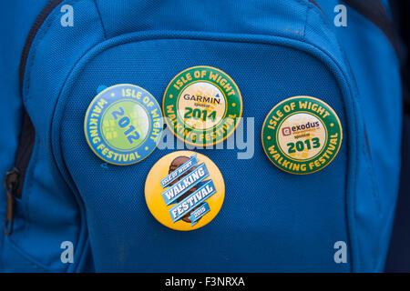 Isle of wight Walking Festival. 2015. Badges on rucksack from previous events - Stock Photo