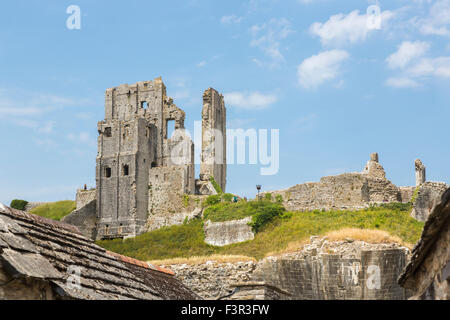 Iconic ruins of hilltop medieval Corfe Castle, a popular leading sightseeing landmark in Wessex, Dorset, southwest - Stock Photo