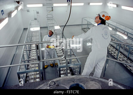 Technicians inside nuclear power plant near Stockholm, Sweden - Stock Photo