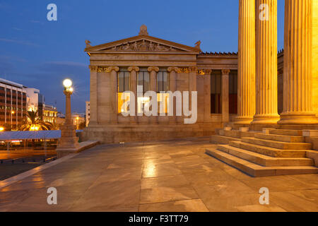 Building of the modern Academy of Athens in Panepistimio and view of Panepistimiou street - Stock Photo