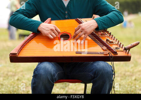 Folk musician playing gusli - Stock Photo