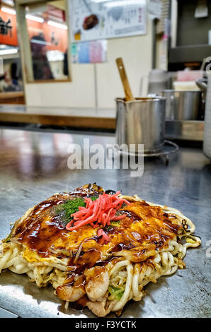 Japan, Honshu island, Chugoku, Hiroshima, famous local food called Okonomiyaki. - Stock Photo