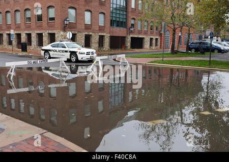 Police car blocking flooded road - Alexandria, Virginia USA - Stock Photo