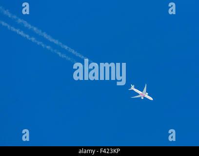 Emirates passenger aircraft flying over the UK - Stock Photo