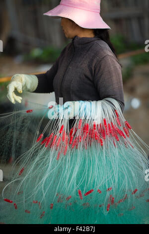 mending the nets, Mũi Né fishing village, Bình Thuận Province, Vietnam - Stock Photo