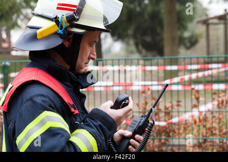 Fireman in action during the spark. - Stock Photo