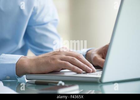 Man using laptop computer - Stock Photo