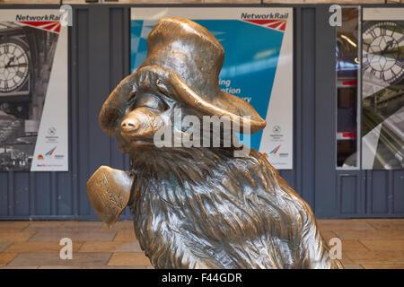 Statue of Paddington Bear at the Paddington Railway Station, London England United Kingdom UK - Stock Photo