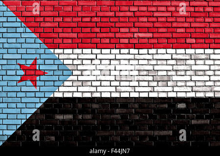 flag of South Yemen painted on brick wall - Stock Photo