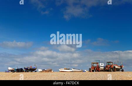 Fishing boats beached on the shingle bank at Cley-next-the-Sea, Norfolk, England, United Kingdom. - Stock Photo