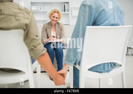 Psychologist helping a couple with relationship difficulties - Stock Photo