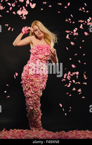 beautiful woman in dress of rose petals - Stock Photo