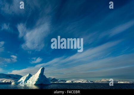 Antarctica, Iceberg floating near Enterprise Island in Wilhelmina Bay along Antarctic Peninsula at sunrise. - Stock Photo