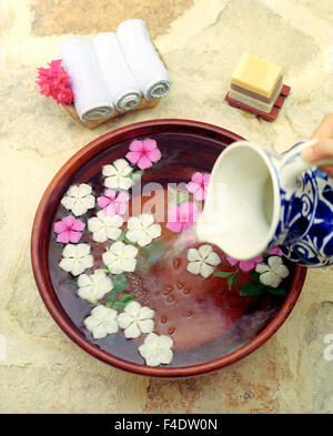 A foot wash with Mexican myrtle flowers  and orange blossom, chocolate truffle, mint soaps. Riviera Maya,Yucatan,Mexico - Stock Photo