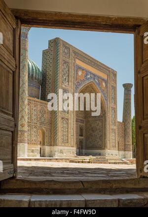Lion Medressa framed in portal of Tilla-Kari Medressa in ancient Silk Road city of Samarkand, Uzbekistan. - Stock Photo