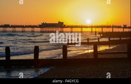 Sunset over Worthing Pier in Worthing, West Sussex, England, UK. - Stock Photo