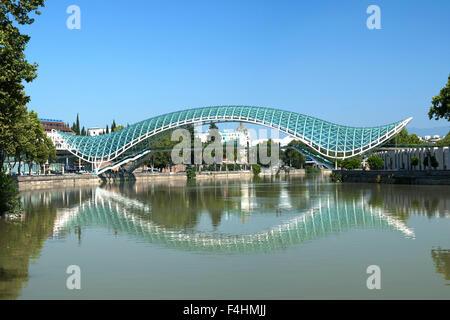 The Bridge of Peace, a pedestrian bridge spanning the Mtkvari River in Tbilisi, the capital of Georgia. - Stock Photo
