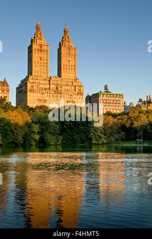 Manhattan Upper West Side across Central Park Lake on Autumn morning. New York City - Stock Photo