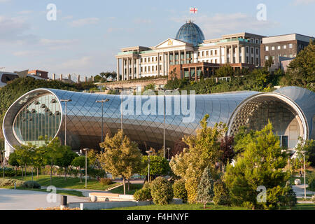 The Rike Park Theater and Exhibition Hall and the Presidential Palace (background) in Tbilisi, the capital of Georgia. - Stock Photo