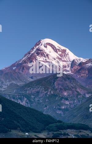 Dawn view of Mount Kazbek (5047m) in the Caucasus Mountains of northern Georgia. - Stock Photo