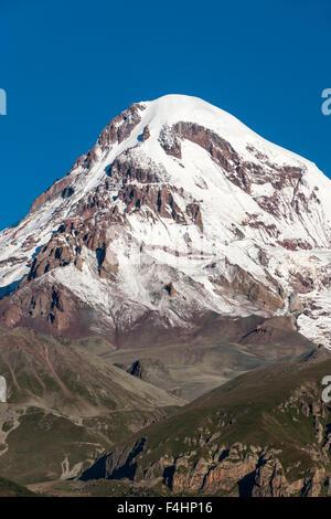 Mount Kazbek (5047m) in the Caucasus Mountains of northern Georgia. - Stock Photo