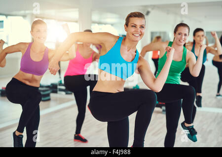 fitness, sport, training, aerobics and people concept - group of people working out in gym - Stock Photo