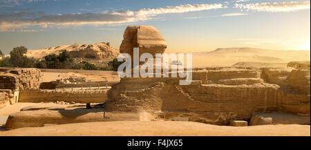 Sphinx in sand desert at the sunset - Stock Photo
