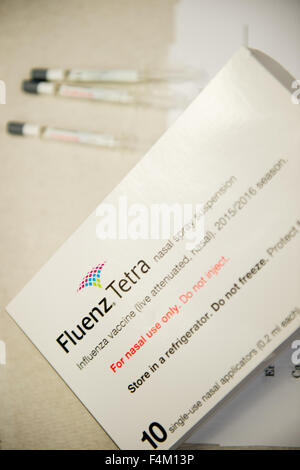 A Packet pack  of 10 doses of Fluenz Tetra influenza flu nasal spray vaccine  for treating children at a primary - Stock Photo