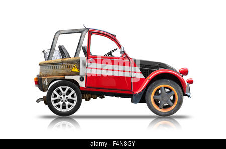 Small buggy car assembled from spare parts. Side view isolated on white background with reflection and soft shadow. - Stock Photo