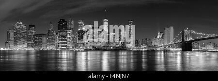 Black and white New York City at night panoramic picture, USA. - Stock Photo