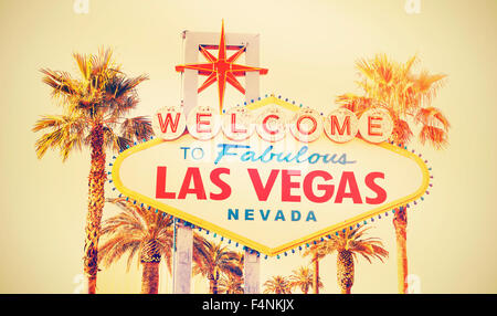Retro cross processed photo of the Welcome To Las Vegas sign, USA. - Stock Photo