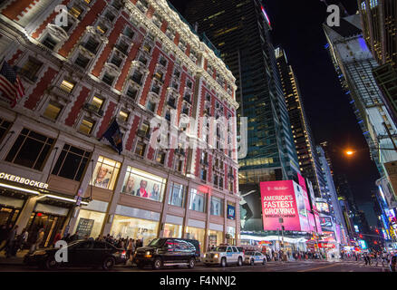 Night time in Times Square, on 42nd Street in Midtown Manhattan, New York City, USA - Stock Photo