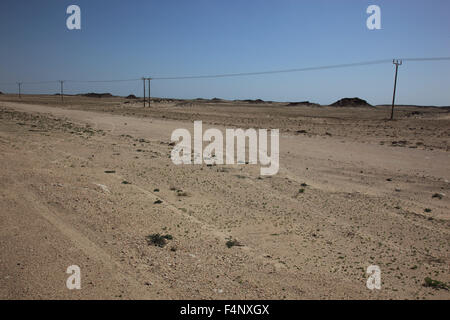 Lonely road through the Empty Quarter, ar-Rub 'al Khali, Oman - Stock Photo