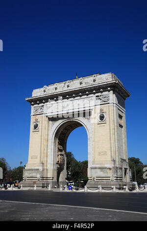 Arcul de Triumf is a triumphal arch located in the northern part of Bucharest, on the Kiseleff Road - Stock Photo