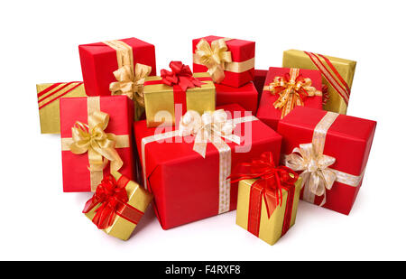 Fashionable pile of red and gold gift boxes with ornate bows, studio isolated on white background - Stock Photo