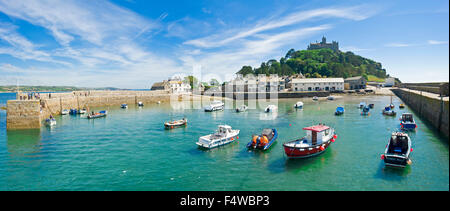 A 2 picture stitch panoramic view of St Michael's Mount with the harbour and village in the foreground. - Stock Photo