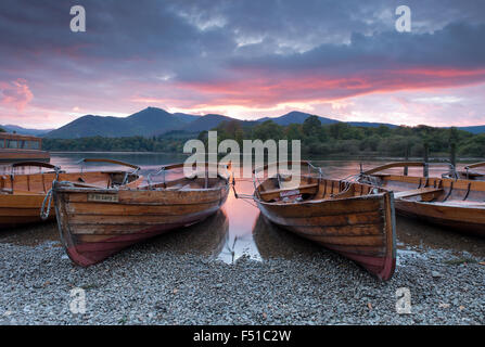 Rowing boats on the shore of Derwent Water near Keswick at sunset, Lake District, Cumbria, England, Uk, Gb - Stock Photo