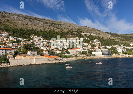View of buildings on the hillside and Mount Srd from the sea in Dubrovnik, Croatia. - Stock Photo