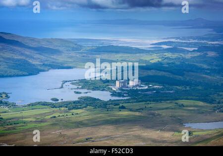 Decommissioned Magnox Trawsfynydd nuclear power station, Traswfynydd lake and coastline of Tremadog Bay Gwynedd - Stock Photo