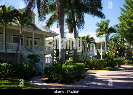 Row of luxury, stylish, winter homes with sundeck and palm trees downtown on Captiva Island in Florida, USA - Stock Photo
