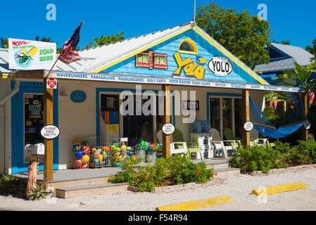 Souvenir and watersports equipment shop Yolo with adirondack chairs and hammock in downtown Captiva Island in Florida, - Stock Photo