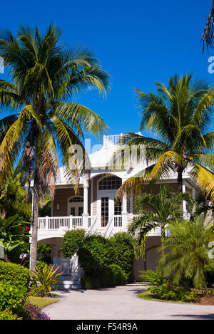 Luxury, stylish, winter home with sundeck and palm trees downtown on Captiva Island in Florida, USA - Stock Photo