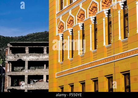 Building of the United World College and ruin in Mostar. - Stock Photo