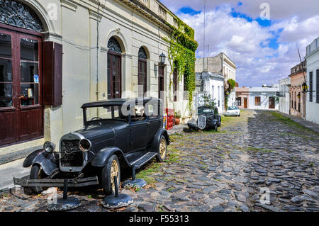 Old black automobile on the street of Colonia del Sacramento, a colonial city in Uruguay. - Stock Photo