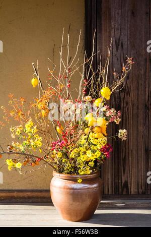 Japan, Hikone castle, Genkyu-en, scenic beauty Japanese garden. Tea house, wityh close up of vase with mini lemon - Stock Photo