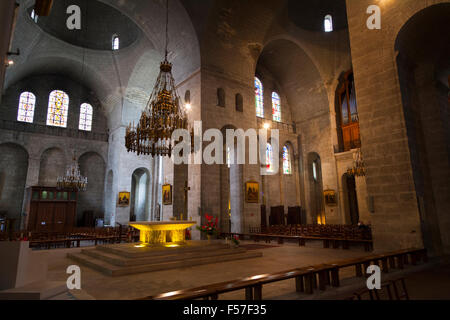 altar with candelabra Inside the cathedral of Saint Front in Perigueux France - Stock Photo
