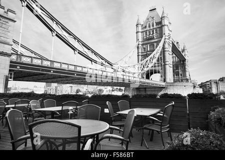 beautiful black and white view of London with cafe on terrace near Tower Bridge - Stock Photo