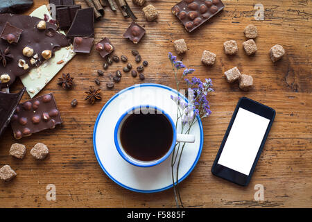 smartphone, sweet food and cup of coffee - Stock Photo